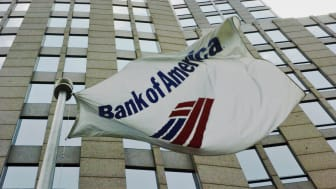 CHARLOTTE, NC - JUNE 30:A flag flies outside the Bank of America Corporate Center June 30, 2005 in downtown Charlotte, North Carolina. Bank of America, which has its corporate headquarters in