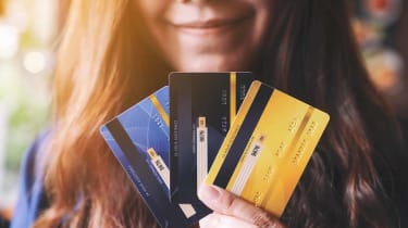 Closeup image of a woman holding and showing credit cards