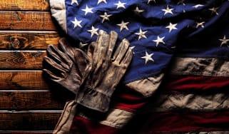 Work gloves lying on an American flag