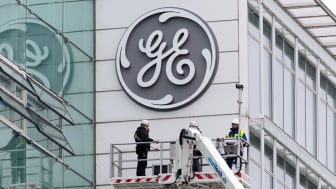 Baden, Switzerland - November 2, 2015: The new General Electric logo has been installed at the former Alstom thermal power headquarters.