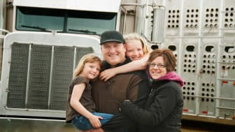 picture of truck driver with his family