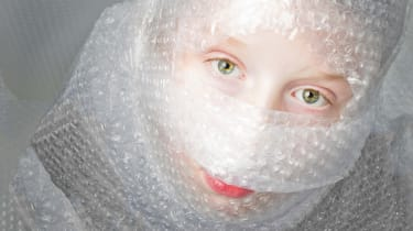 A woman is all wrapped up in bubble wrap.