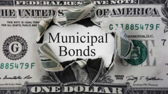 "picture of a dollar bill with a hole in it and ""municipal bonds"" written in the hole"