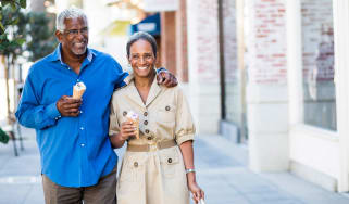 couple walking eating ice cream cone