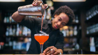 picture of a bartender pouring a drink