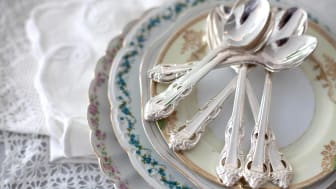 A setting of fancy china and silverware.