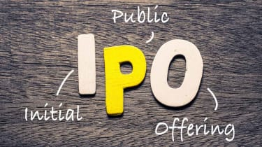 IPO wooden alphabets on wood background with text acronym (Initial Public Offering)