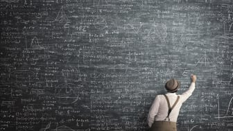 picture of chalkboard full of calculations