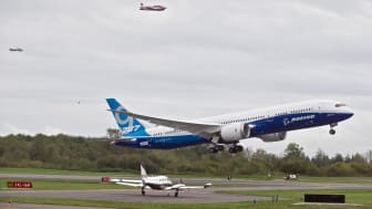 EVERETT, WA - SEPTEMBER 17:Flanked by a pair of chase planes a Boeing 787-9 Dreamliner lifts off for its first flight September 17, 2013 at Paine Field in Everett, Washington. The 787-9 is tw
