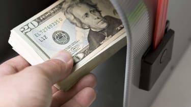 Studio shot of cash in a mailbox