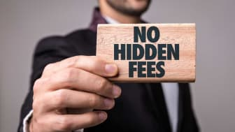 """picture of man holding small sign saying """"no hidden fees"""""""