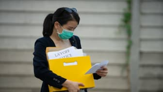 picture of woman with layoff notice