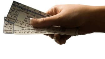 Woman holding concert tickets