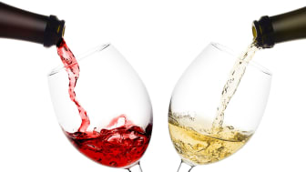 Red and white wine being poured into glasses