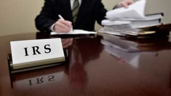 picture of IRS agent at his desk