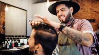 Barber cutting client's hair