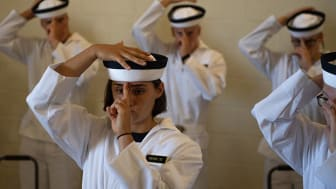 picture of Naval Academy midshipmen on learning how to wear their hat