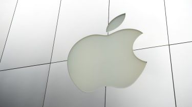 San Francisco, USA - August 4, 2011: Apple Computers logo sits in brushed metal facade of a store in Union Square. Apple's control over branding and the consumer experience is legendary, and