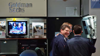 NEW YORK - DECEMBER 16:Financial professionals laugh in the Goldman Sachs booth on the floor of the New York Stock Exchange during afternoon trading December 16, 2008 in New York City. The Fe