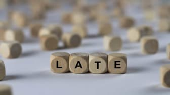 "picture of blocks spelling ""late"""