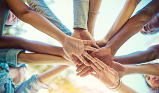 Cropped shot of a group of friends with their hands piled on top of each other