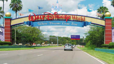 Lake Buena Vista, Florida, USA - August 19, 2015: an entrance of Walt Disney World Resort. Some cars are visible.