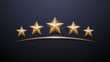 five gold stars on black background