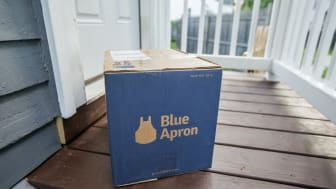 BOSTON, MA - JUNE 28: In this photo illustration, a Blue Apron box sits on the porch of a house on June 28, 2017 in Boston, Massachusetts. The online meal-kit delivery company is going public