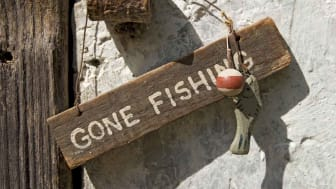 "A sign reads ""gone fishing"""
