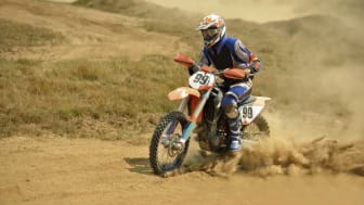 picture of person racing on a dirt bike