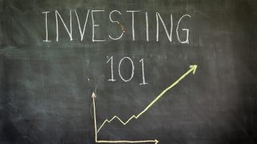"""""""Investing 101"""" written in chalk on blackboard."""