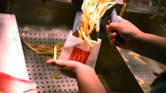 MIAMI, FL - APRIL 25:McDonald's crew member Samantha Medina prepares french fries as the McDonald's restaurant stock price reached record territory on April 25, 2017 in Miami, Florida.The com