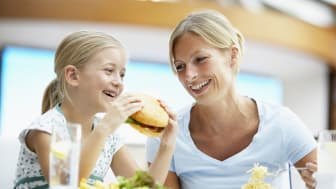 A mother and daughter eating at a restaurant
