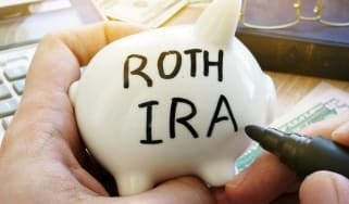 Piggy bank with Roth IRA written on it