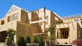 New Home Construction progress wood frame design landscaped sky