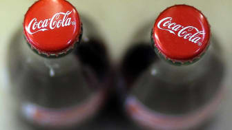 SAN FRANCISCO, CA - APRIL 16:Bottles of Coca Cola are displayed at a market on April 16, 2013 in San Francisco, California.Share prices of Coca Cola Co. surged as much as 5.8% today after the
