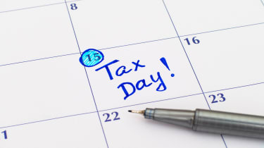 """picture of calendar with 15th day circled and """"Tax Day"""" written on it"""