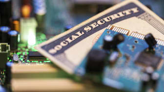 Social Security card and circuit board. Internet Security concept.