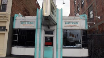 Old White Tower restaurant in a city, squeezed in by two larger buildings