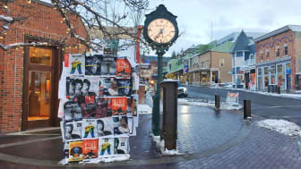 January 26, 2018-Park City, Utah: Sundance movie posters next to clock on Main Street in park city where the film festival is held every year