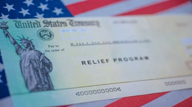 picture of government relief program check on top of an American flag