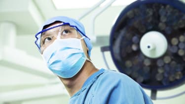 Surgeon wearing a surgical mask and glasses in operating room