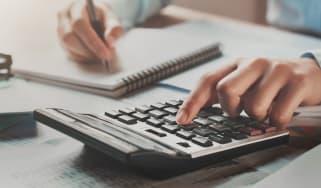 picture of a person using a desk calculator
