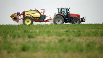 PRENZLAU, GERMANY - MAY 19:A tractor spreads pesticide on a field on May 19, 2016 near Prenzlau, Germany. Debates among member states of the European Union today in Brussels ended without a v