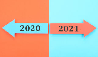 drawing of an arrow labeled 2020 and an arrow labeled 2021 pointing in opposite directions