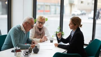 Senior couple with financial planner