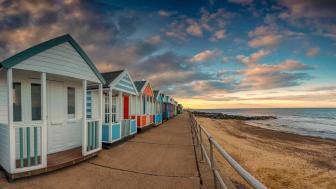 A row of small beach houses.