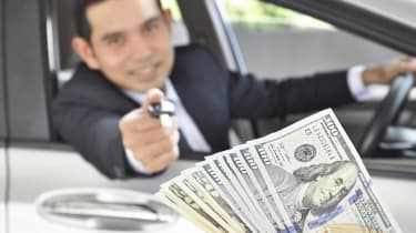 Man giving car key exchanging with money- car pawn