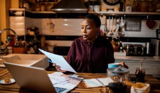 Woman doing home finances in the evening.