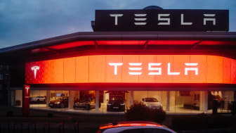 London:View from the street of Tesla Motors showroom with multiple luxury Tesla cars inside. Tesla is an American company that designs, manufactures, and sells electric cars